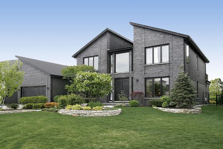 Modern home with gray brick and black door