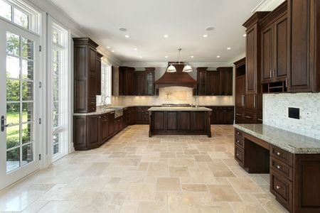Large kitchen in new construction home with wood cabinetry