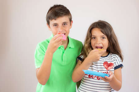 Photo for Two friends eating a piece of cake - Royalty Free Image