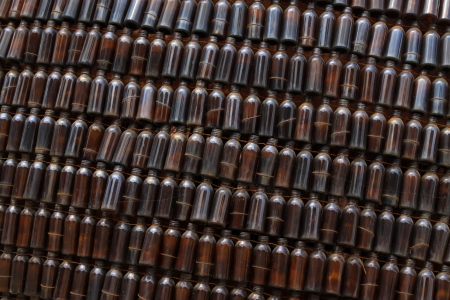 Rows of brown glass bottles in a park