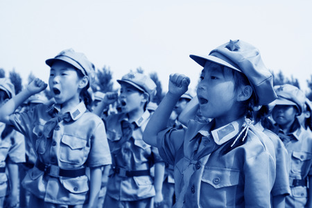 LUANNAN COUNTY - JULY 16: The Elementary student dressed in blue military uniform, solemnly swear, on July 16, 2012, luannan county, Hebei province, China