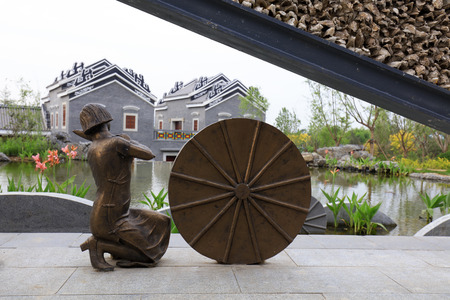Tangshan City - May 28, 2016: Women sculpture in the park, Tangshan City, Hebei, China