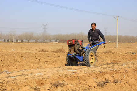 Luannan County - March 16, 2018: farmers are leveling the land, ready for farming, Luannan, Hebei, China