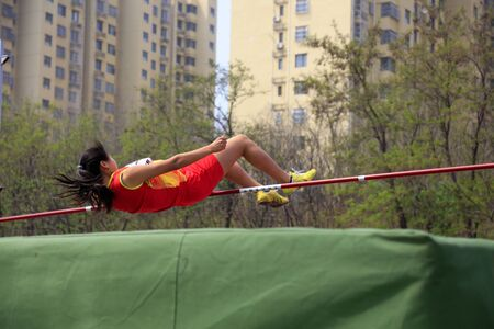 Photo pour Women high jump scene at middle school sports meeting - image libre de droit