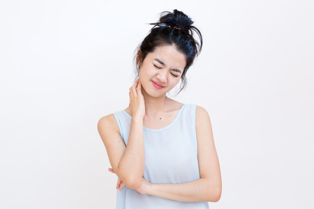 Young asian student suffering from a neck pin