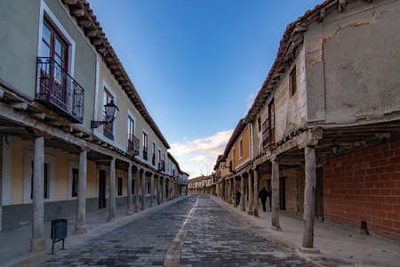 Ampudia, Palencia, Spain; February 2107: medieval street with arcaded buildings, landmark and monument from seventeenth century, in Ampudia village