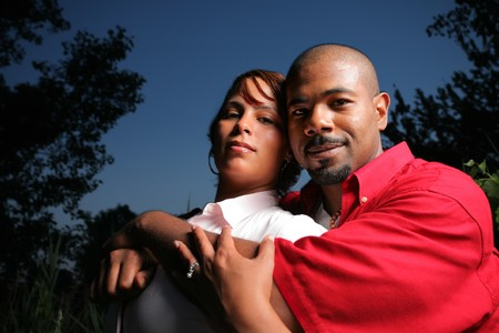 Happy African American couple together outdoors, close-up.