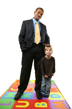 Tall African American businessman together with small caucasian boy.