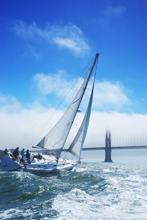 Beautiful yacht in San Francisco bay Golden Gate bridge on the horizon. California USA