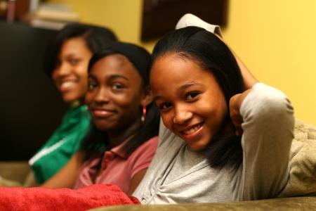 Three cute teenage sisters together. Shallow DOF.