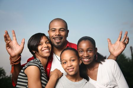 Photo for Happy African American family. Father with three teenage daughters together having a good time. - Royalty Free Image
