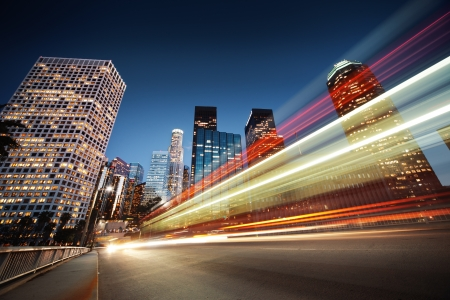 Foto de Los Angeles at night. Long exposure shot of blurred bus speeding through night street. - Imagen libre de derechos
