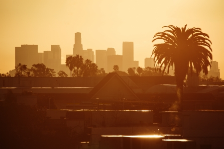 Golden Los Angeles city skyline in morning.