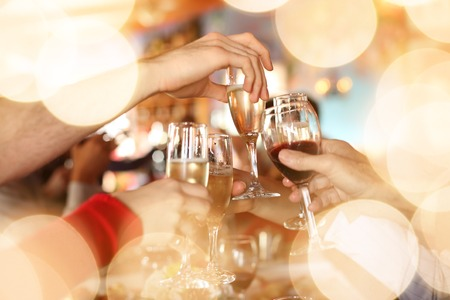 Photo pour Celebration. Hands holding the glasses of champagne and wine making a toast. - image libre de droit