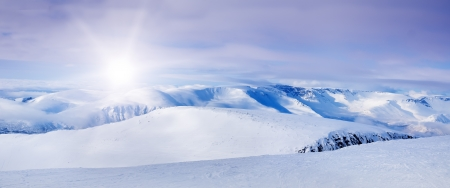 Snowy arctic mountains in sunny day の写真素材