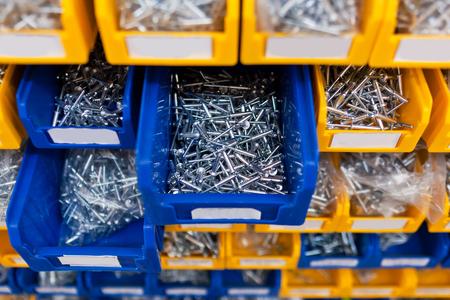 Photo pour Sorted rivet in boxes in the store. - image libre de droit