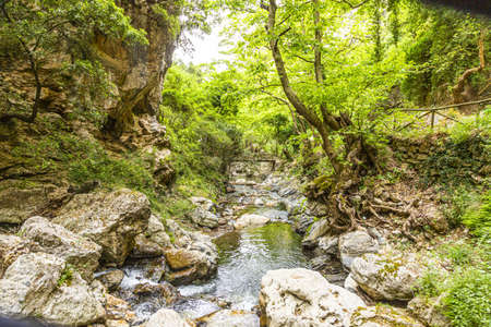 Old wooden bridge on hiking path on the greek island of crete in summer