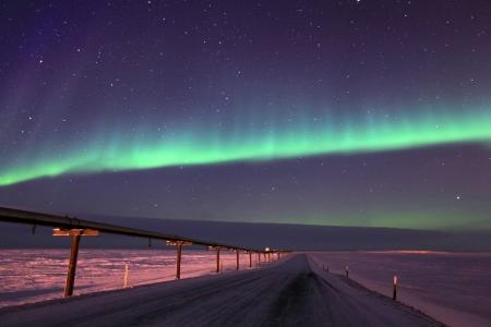 Northern Lights Over Oil Pipeline