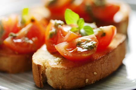 Photo for juicy tomatoes on fresh bread, pesto as topping - Royalty Free Image