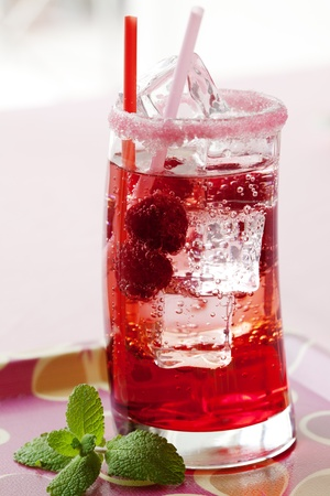 glass of ice cold raspberry spritzer orjustsoda