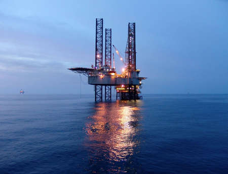 Offshore oil rig before sunrise