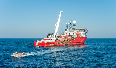 Dynamically positioned diving support vessel lunched inflatable boat with a divers