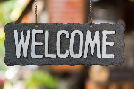 Photo for Welcome vintage wooden sign on a soft background blur. - Royalty Free Image