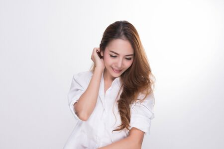 Photo pour Asian woman portrait with perfect skin and wearing a white shirt in profile isolated on gray background. - image libre de droit
