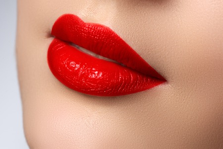 Sexy Lips. Beauty red lips makeup detail. Beautiful make-up closeup. Sensual mouth. Lipstick and lipgloss.  Beauty model woman's face close-up