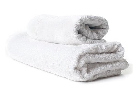 Two clean white terry towels on white background