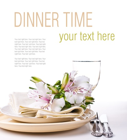 Table setting with white alstroemeria flowers, napkins and yellow plates, close-up, ready template
