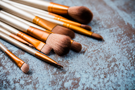 Professional makeup brushes collection, new make-up tools set on painted background with copy spaceの写真素材
