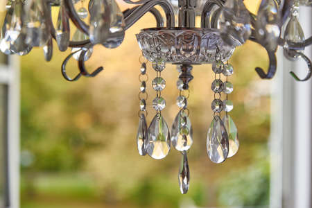 Closeup of a reflecting crystal chandelier. Vintage chandelier.