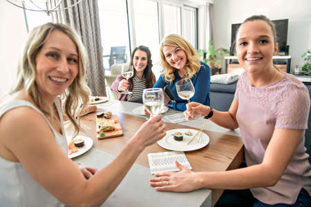 Photo for Group of attractive mature people eating sushi at home - Royalty Free Image