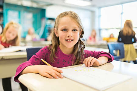 Photo for education and school concept little student girl studying at school - Royalty Free Image