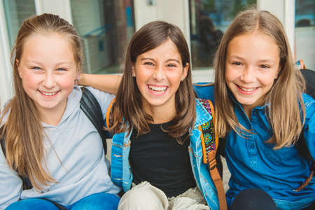 Photo for Some nice kids on the school background having fun - Royalty Free Image