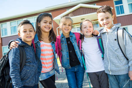 Photo for students outside school standing together - Royalty Free Image