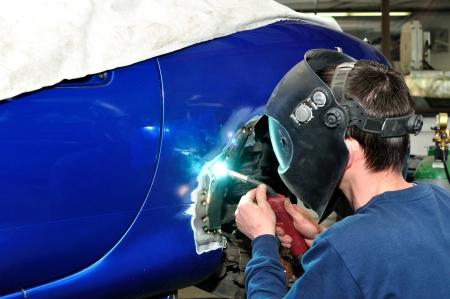 worker welding car body