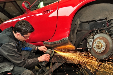 Worker repairing car body