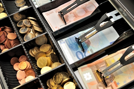 Euro banknotes and coins in a cashbox