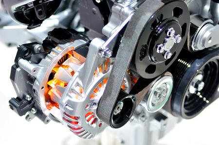 Photo pour Very hot car alternator with drive belt. - image libre de droit
