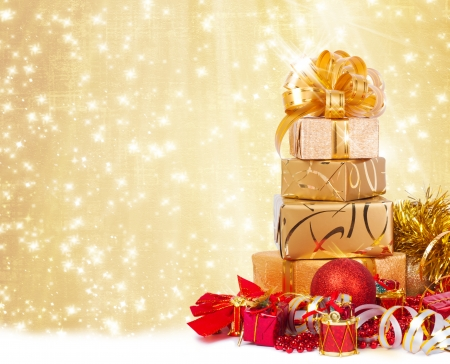 Gift box in gold wrapping paper on a beautiful abstract background