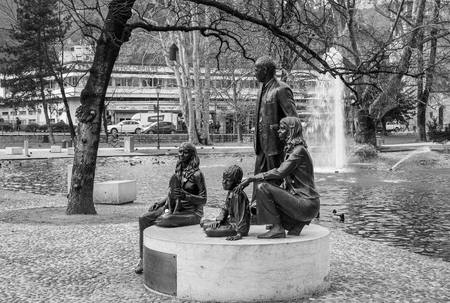 Foto per Family monument of the British artist Gillian Wearing.The bronze statue (2007) represents the typical Trentino family. Image in Black and White. - Immagine Royalty Free