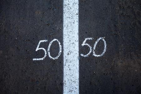 Foto de Symbol of gender equality 50/50 on asphalt - Imagen libre de derechos