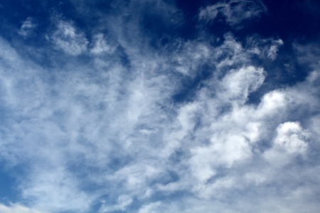 White clouds on the blue sky before the stormの写真素材