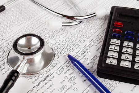 Photo pour Healthcare costing. Medical phonendoscope, calculator, pen. - image libre de droit