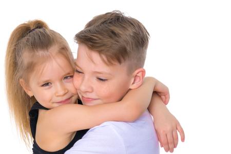Photo pour Brother and sister embrace. - image libre de droit