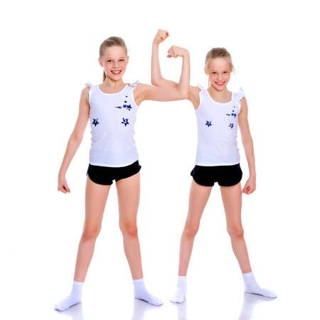 Foto de Girls gymnasts show their muscles. - Imagen libre de derechos