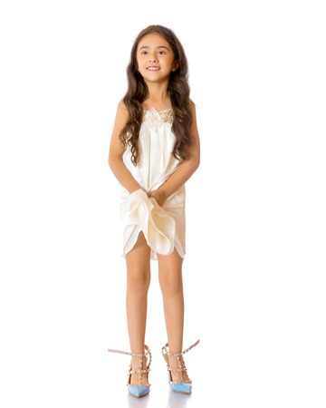 A small Asian girl in high-heeled shoes.