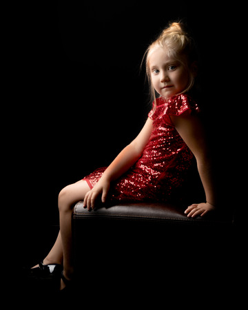 Photo for Little girl on a black background - Royalty Free Image